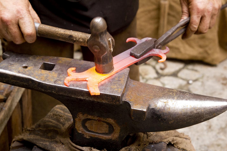 blacksmith forged iron smith anvil hammerman traditional hammer beating