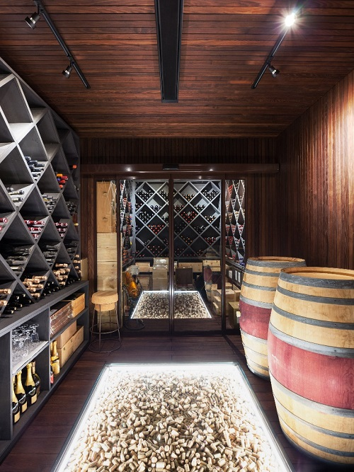 luxury cellar of prestigious house, shelves full of bottles