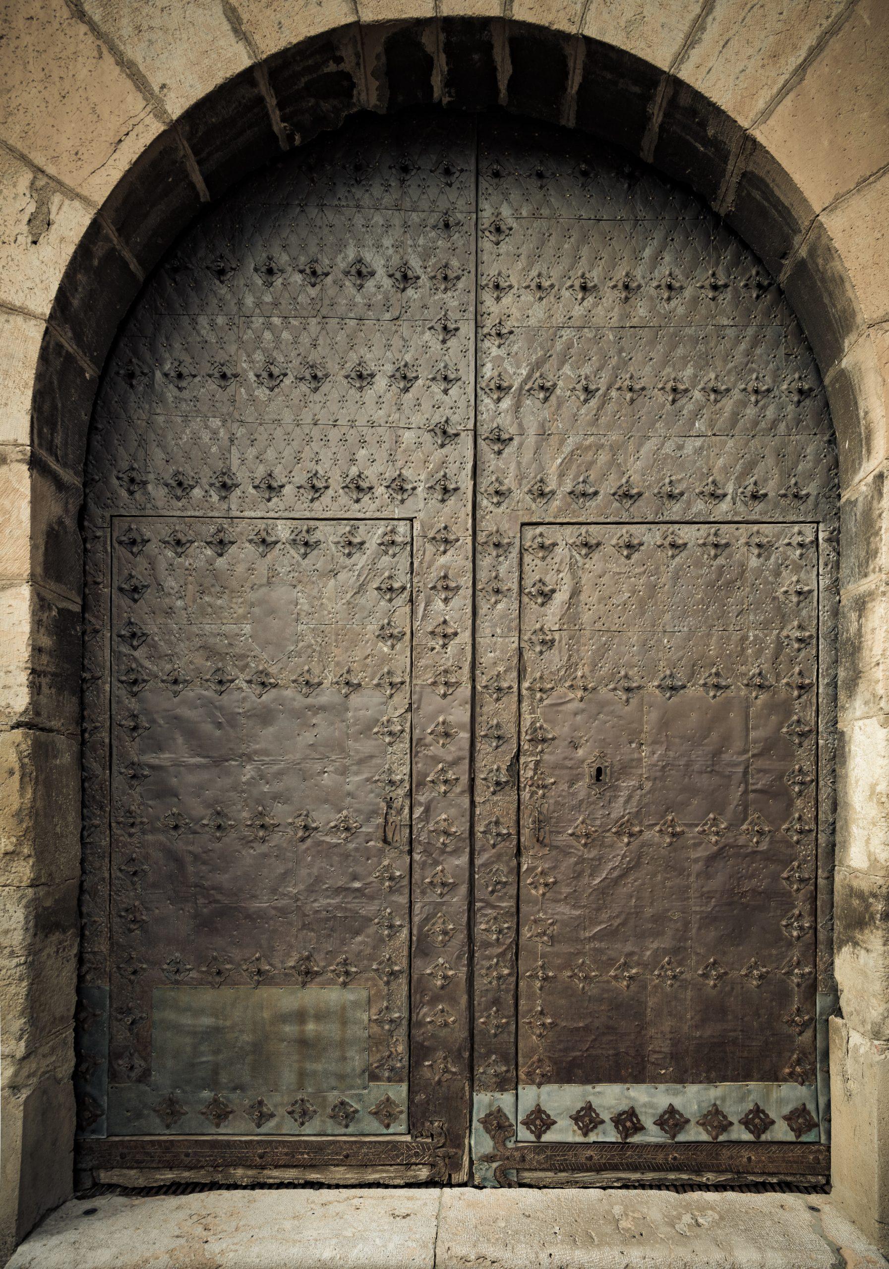 Old iron door in a medieval building