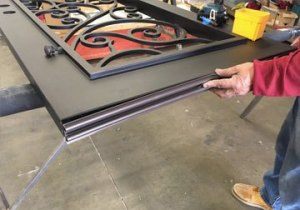 Man Worker Working On Custom Iron Doors