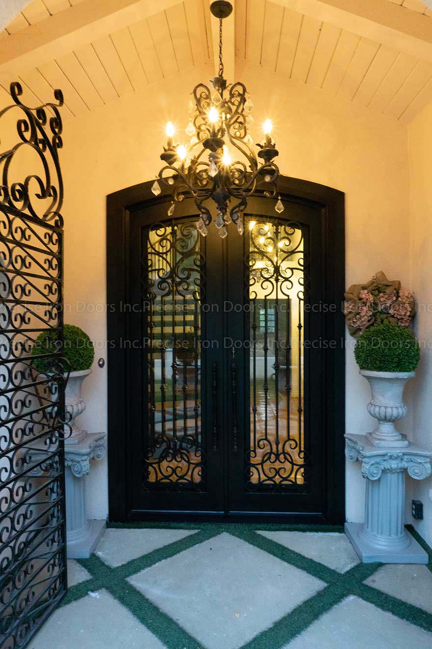 vermont ornate steel double entrance doors with scrollwork