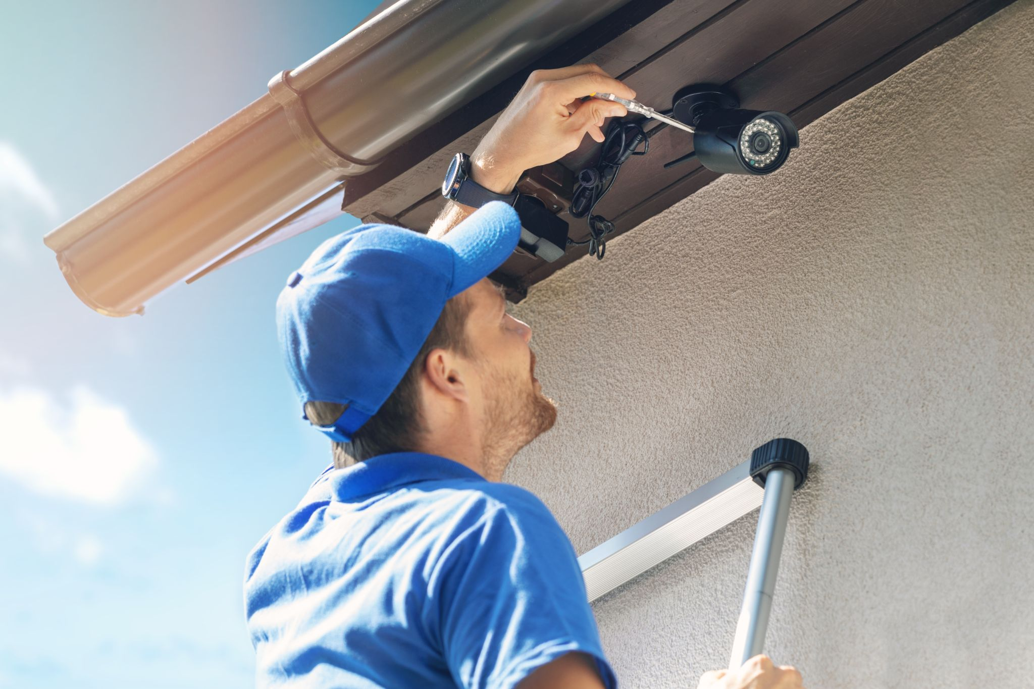 man install outdoor surveillance camera for home security